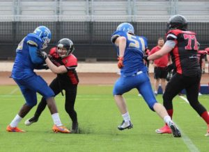 Greg Morgan with a strip sack for 6 points
