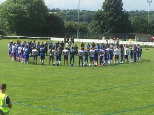 Titans and Leeds Academy stand together